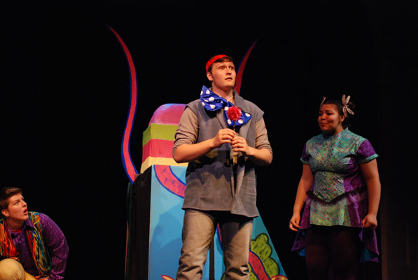 """Students rehearse a scene from """"Seussical: The Musical."""" Senior Ian Mooney stars as Horton the Elephant, junior Lauren Johnson as Gertrude McFuzz, and senior Liam Tobey as one of the Wickersham brothers. Photo by Bryn Estlund."""